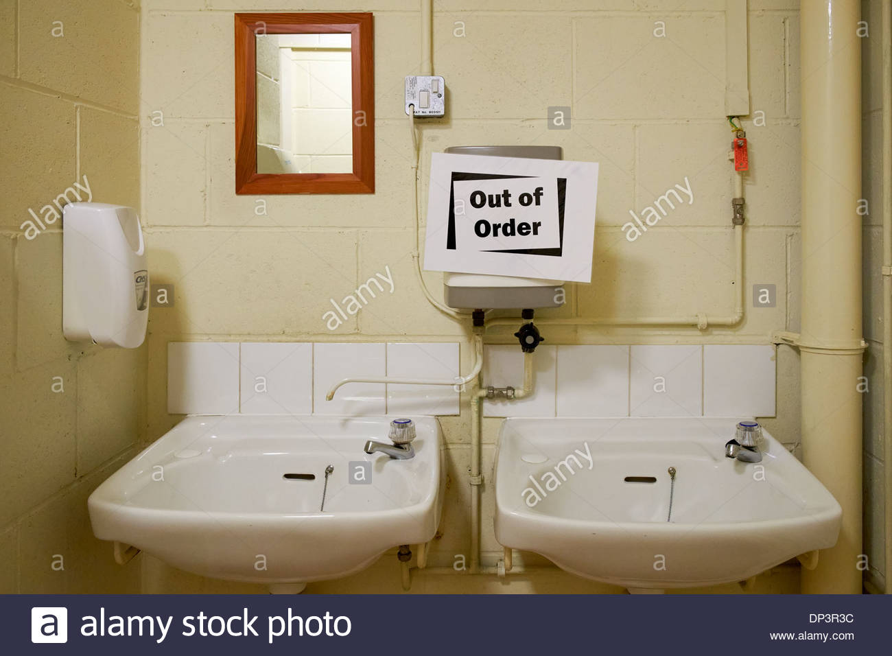 Out of order sign on hot water heater above washbasins in for Bathroom hot images