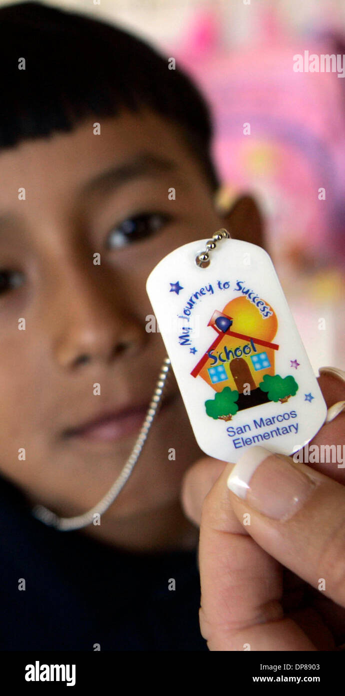 Principal <b>CANDY SINGH</b>(cq)holds a &#39;&#39;tiger tag&#39;&#39; belonging to JHOVANNY ... - published-09162006-ni-1-september-6-2006-san-marcos-elementary-school-DP8903