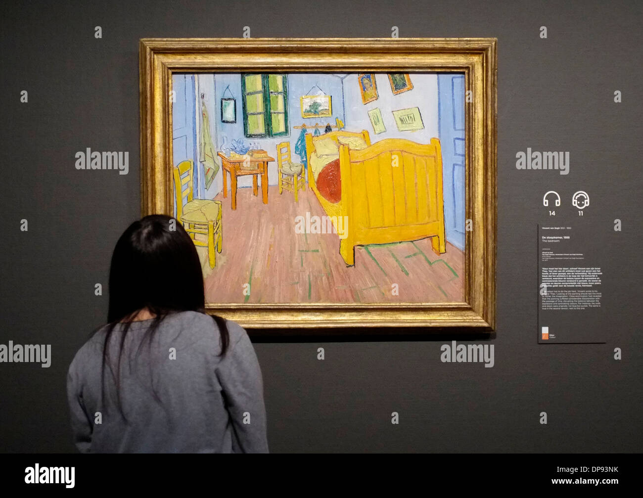 visitor to the van gogh museum in amsterdam perusing worksvan