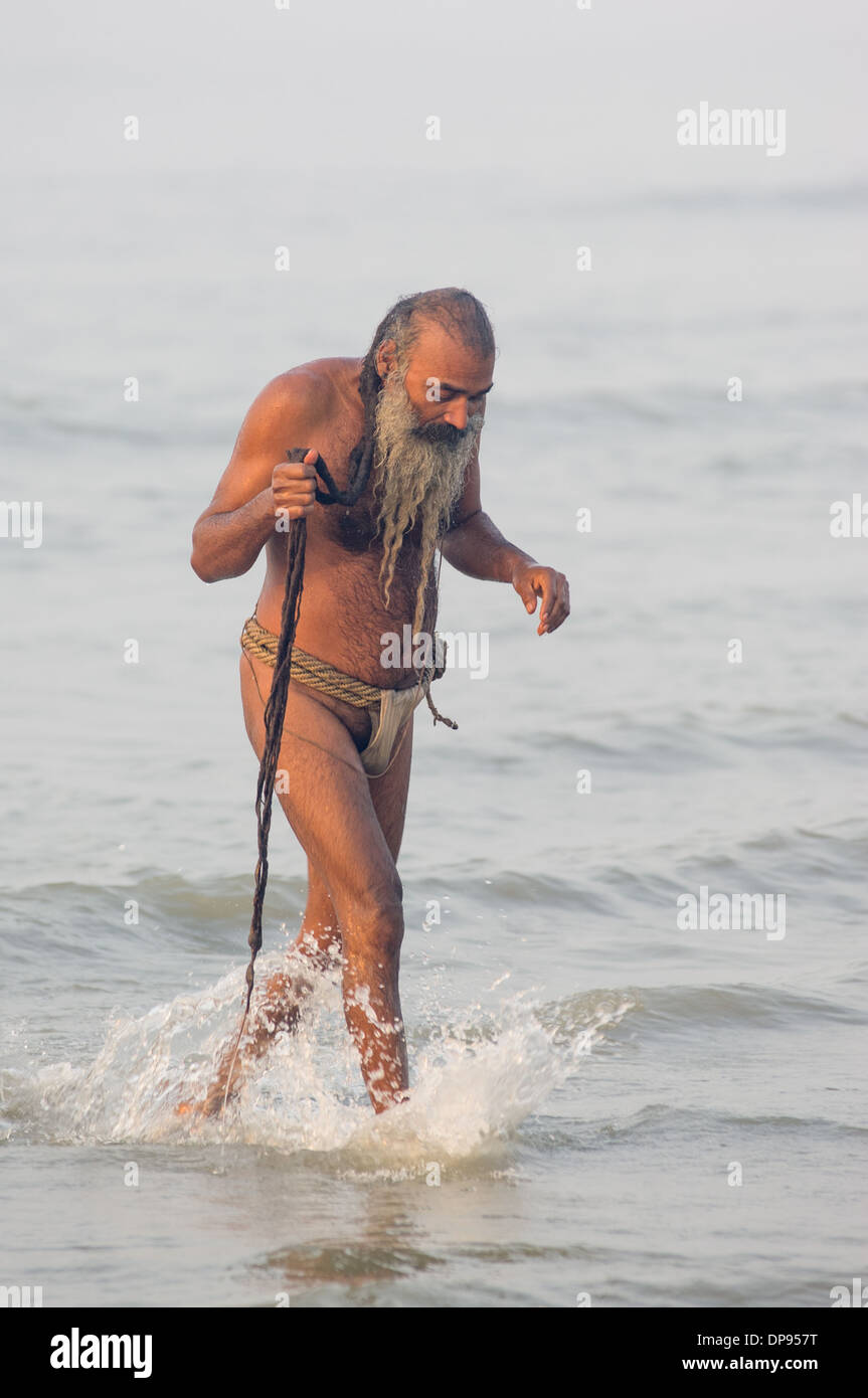 loincloth  boy Indian sadhu with long dreadlocks and a loin cloth walking in the Bay of  Bengal at