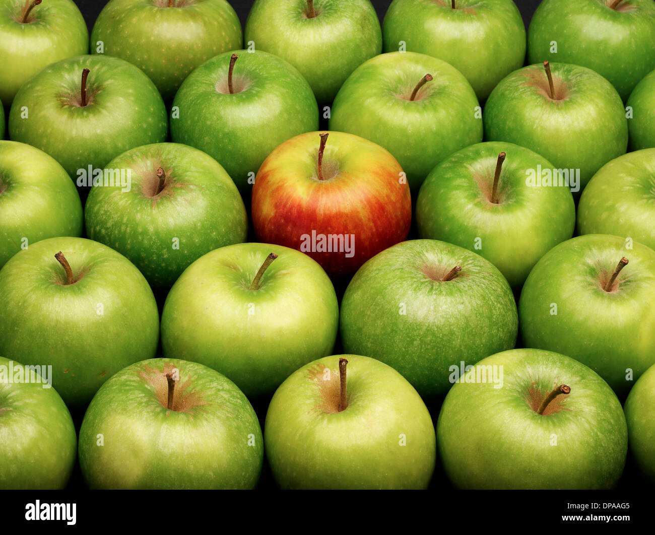 green and red apples. group of green apples with one red apple and