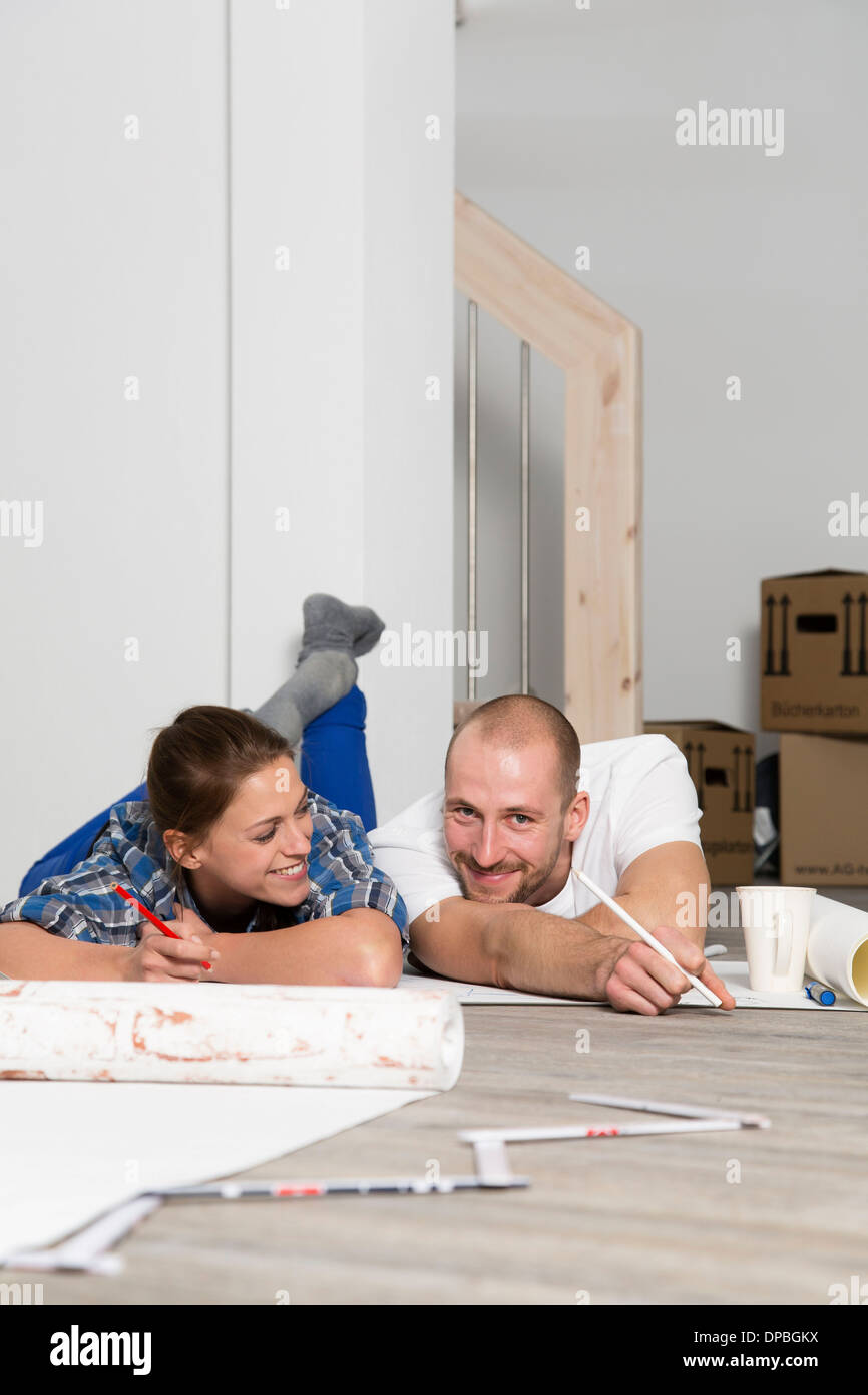 Young couple moving into new home taking a break stock photo royalty free image 65408110 alamy - Young couple modern homes ...