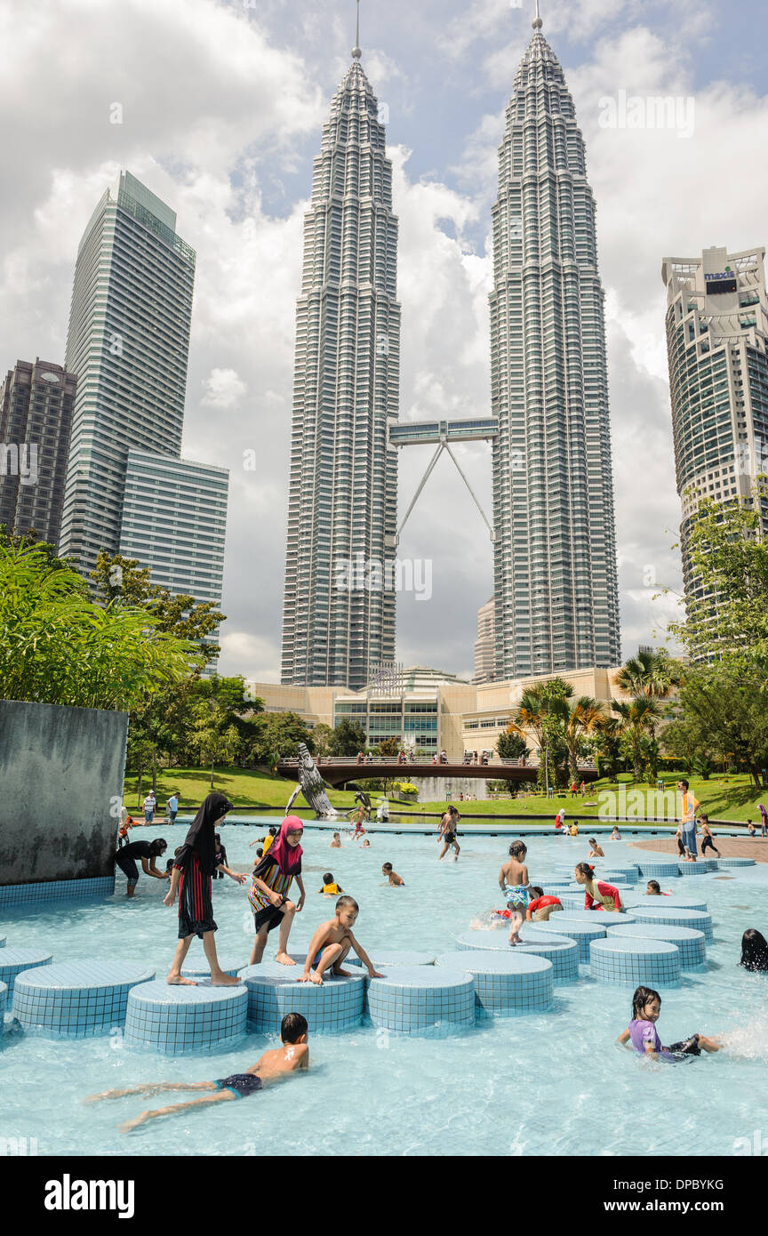 People enjoying the swimming pools nearby petronas towers - Homestay in kuala lumpur with swimming pool ...