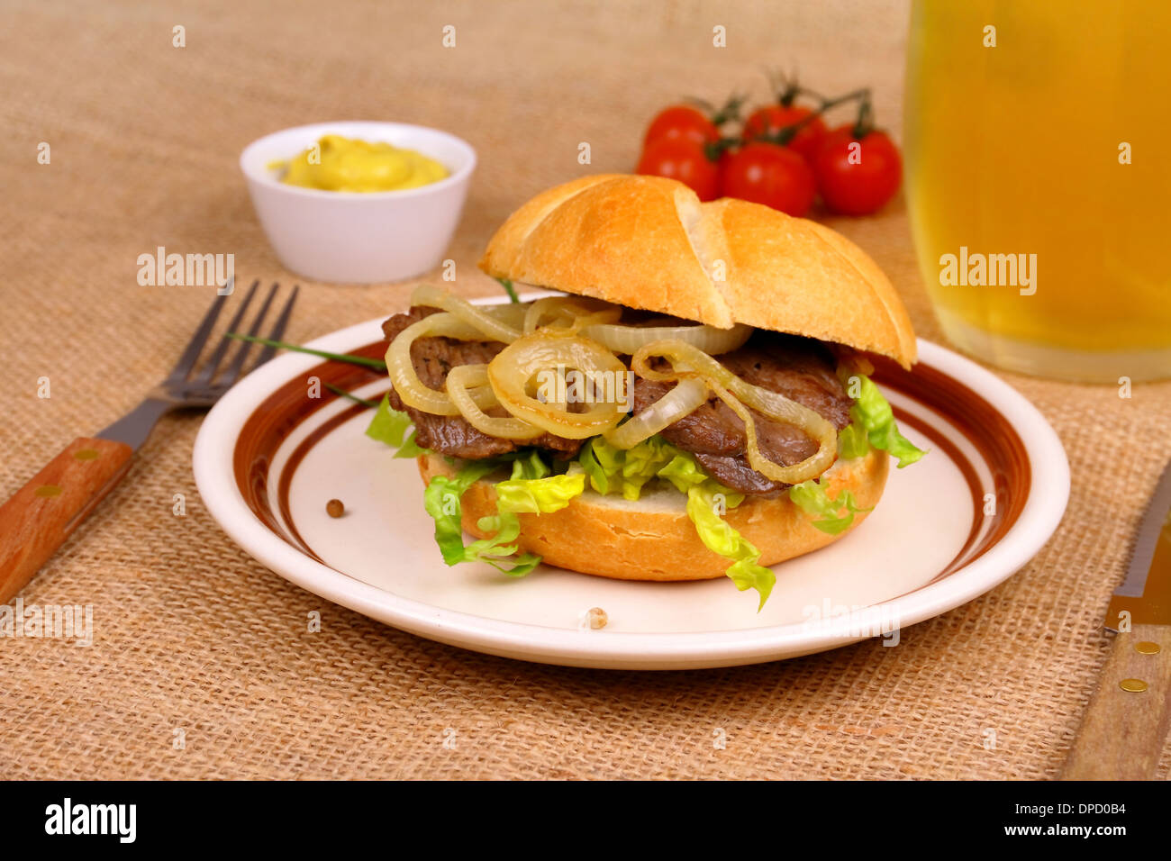 grilled beef with onion rings in bun mustard beer close up stock photo royalty free image. Black Bedroom Furniture Sets. Home Design Ideas
