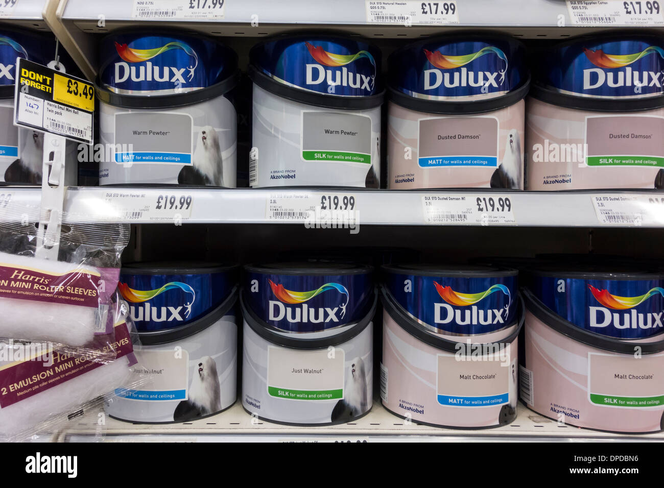 dulux emulsion paint tins displayed on shelf at homebase. Black Bedroom Furniture Sets. Home Design Ideas