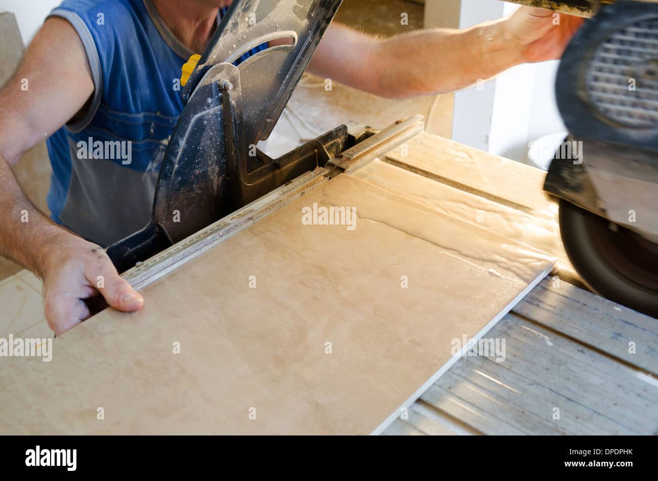 A wet saw cutter is being used to cut floor tile stock photo a wet saw cutter is being used to cut floor tile dailygadgetfo Choice Image