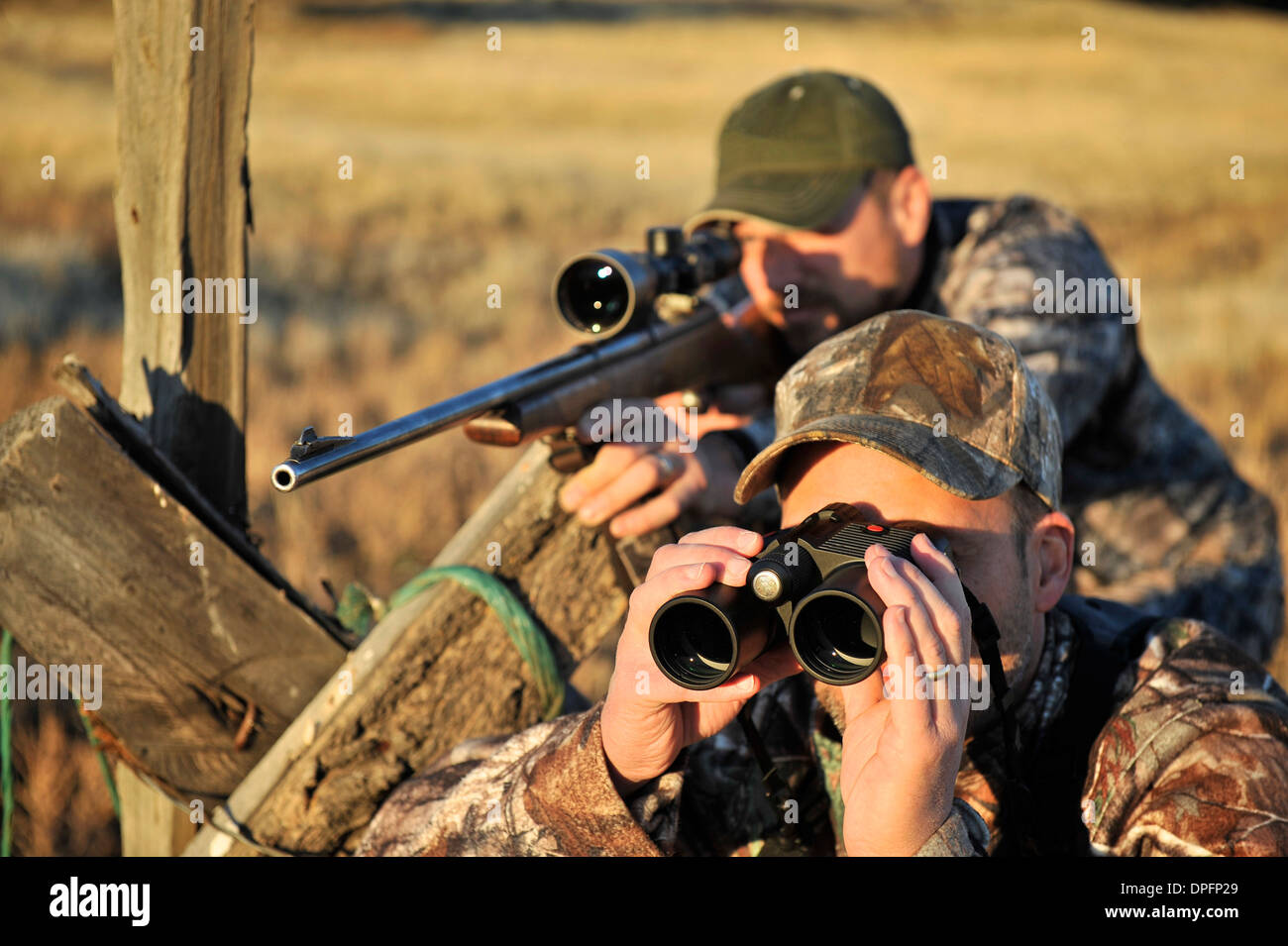 johnday elena kazan gets lifetime experience while filming john  two deer hunters rifle and binoculars john day oregon usa stock photo two deer hunters rifle