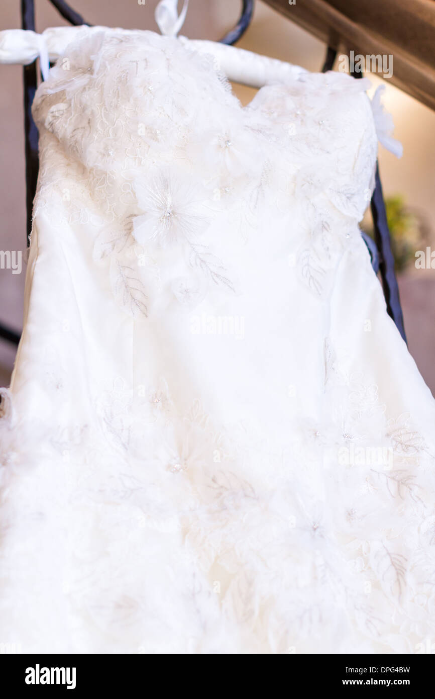 Vintage wedding dress on a hanger Stock Photo: 65508237 - Alamy
