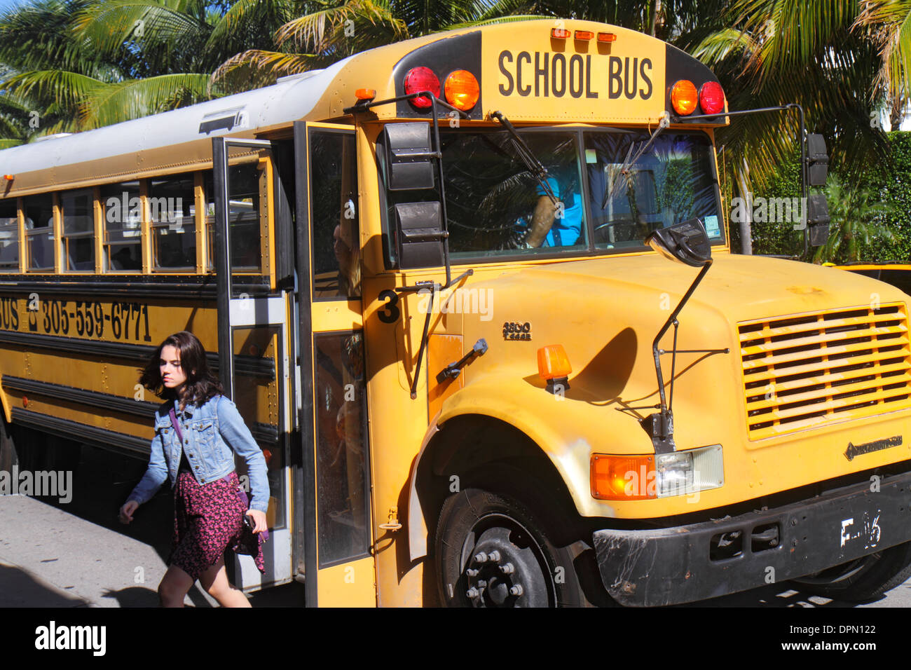 Kids Getting Off A School Bus