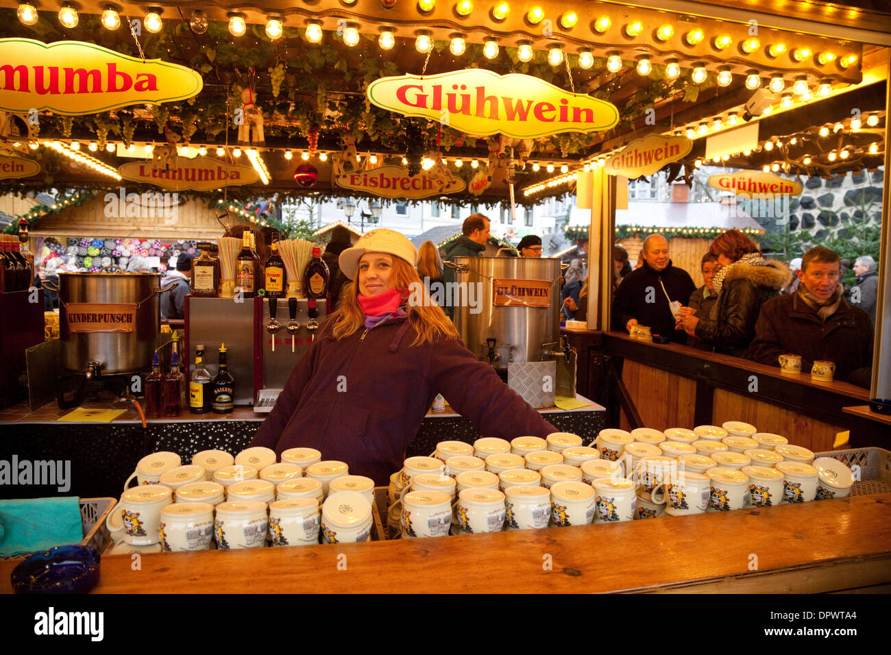 Gluhwein stall, mulled wine for sale with stallholder, at the ...