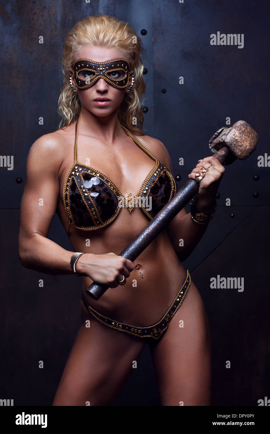 [Image: young-sexy-strong-woman-with-hammer-DPY0PY.jpg]