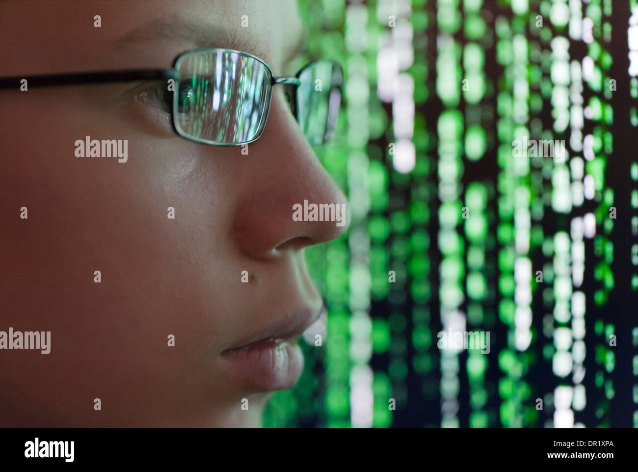 A young man with glasses is watching futuristic symbols on a a young man with glasses is watching futuristic symbols on a computer screen symbols are biocorpaavc Choice Image