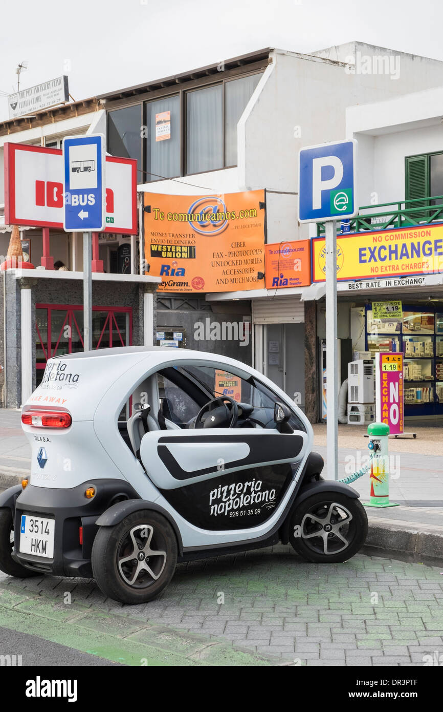 renault twizy battery powered electric car for pizza delivery plugged stock photo royalty free. Black Bedroom Furniture Sets. Home Design Ideas