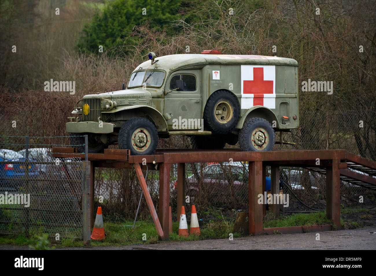 Old us army ambulance on ramp outside garage at peterchurch herefordshire england uk stock image