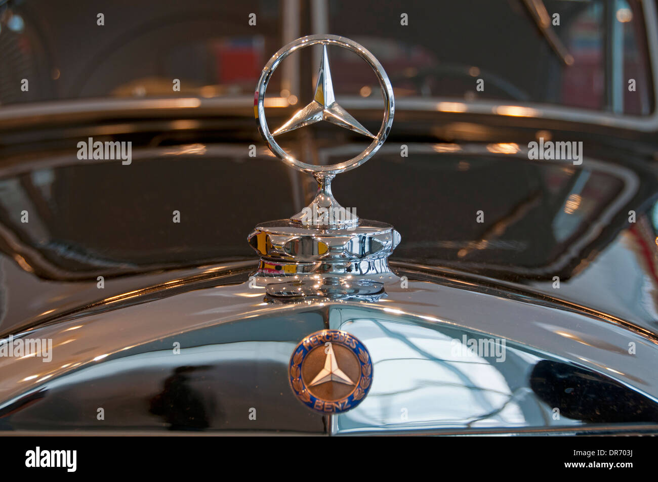 Mercedes benz star on car bonnet stock photo royalty free for Star motor cars mercedes