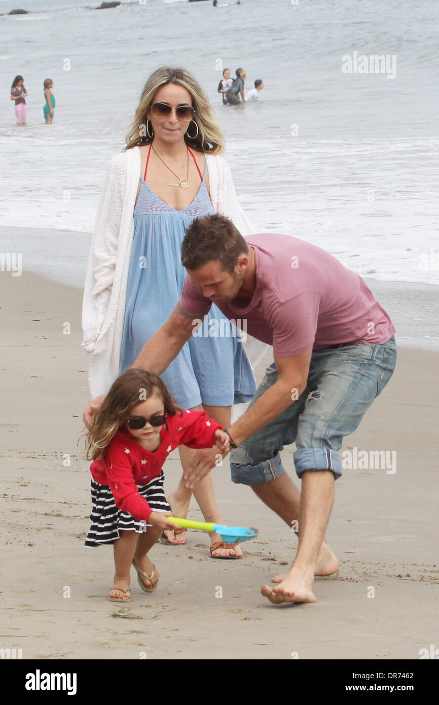 Cam Gigandet and his wife Dominique Geisendorff walk with ...