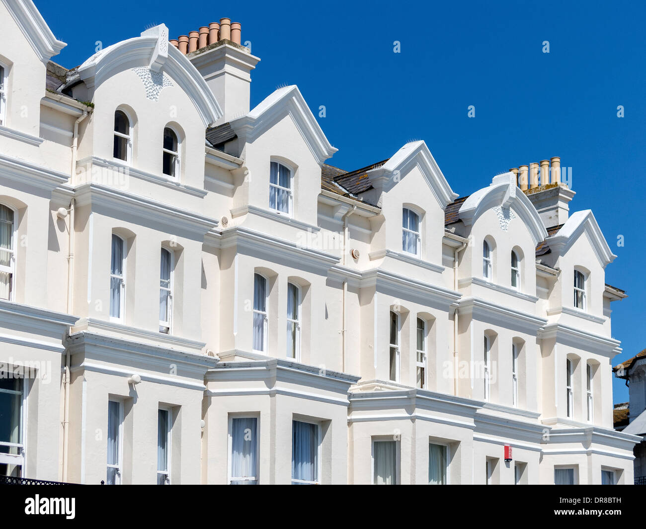 Sunlit white painted victorian terrace seafront front for Terrace white