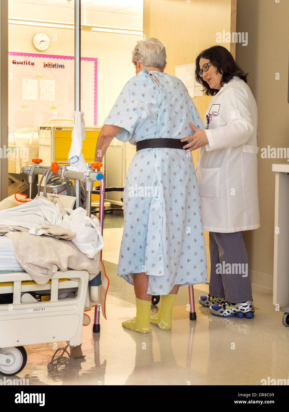 California physical therapy - A Physical Therapist Helps A Hip Surgery Patient Use A Walker In A Southern California Hospital
