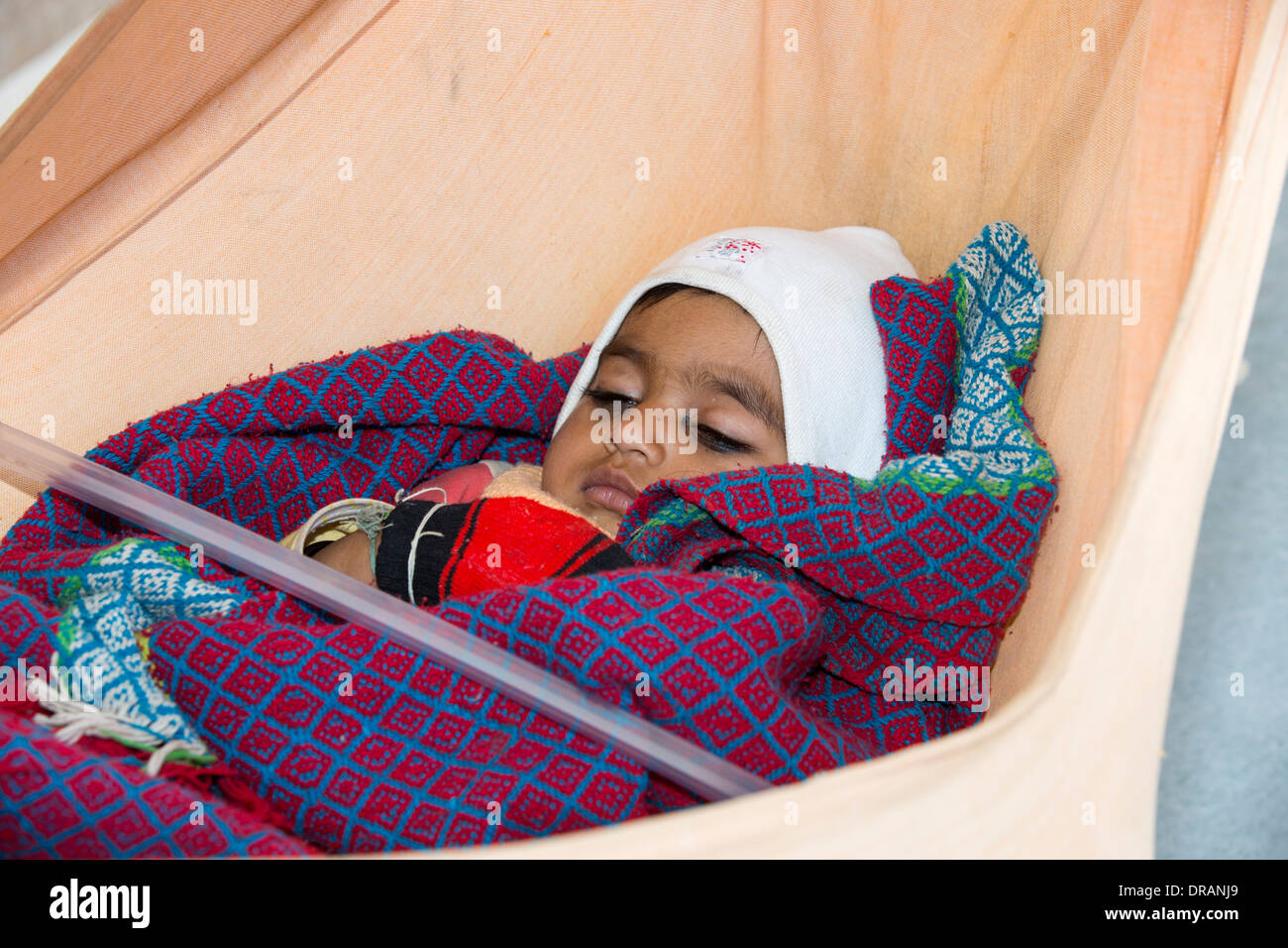 a baby in a hammock in rajasthan india a baby in a hammock in rajasthan india stock photo royalty free      rh   alamy