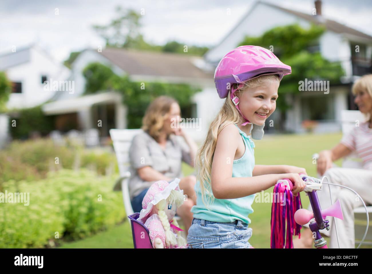 girl-riding-bicycle-in-backyard-DRC7TF.j