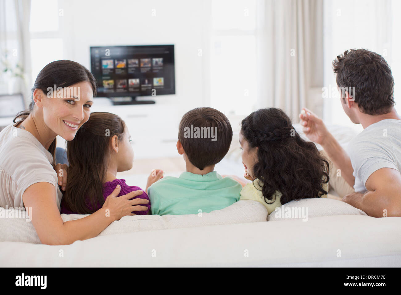 Family watching tv in living room stock photo royalty for Living room channel 7