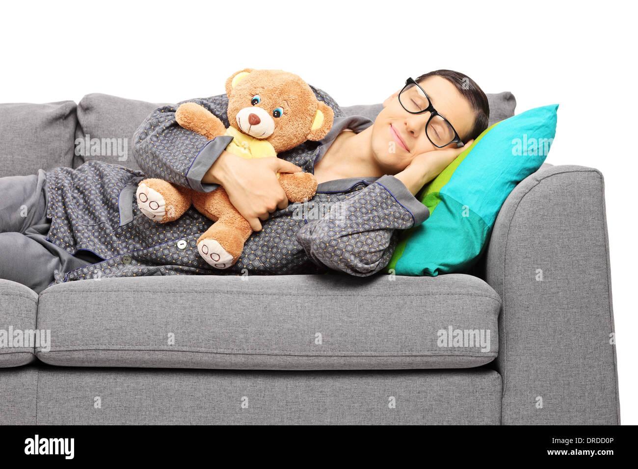 Young Guy Sleeping On Sofa Stock Photos & Young Guy Sleeping On ...