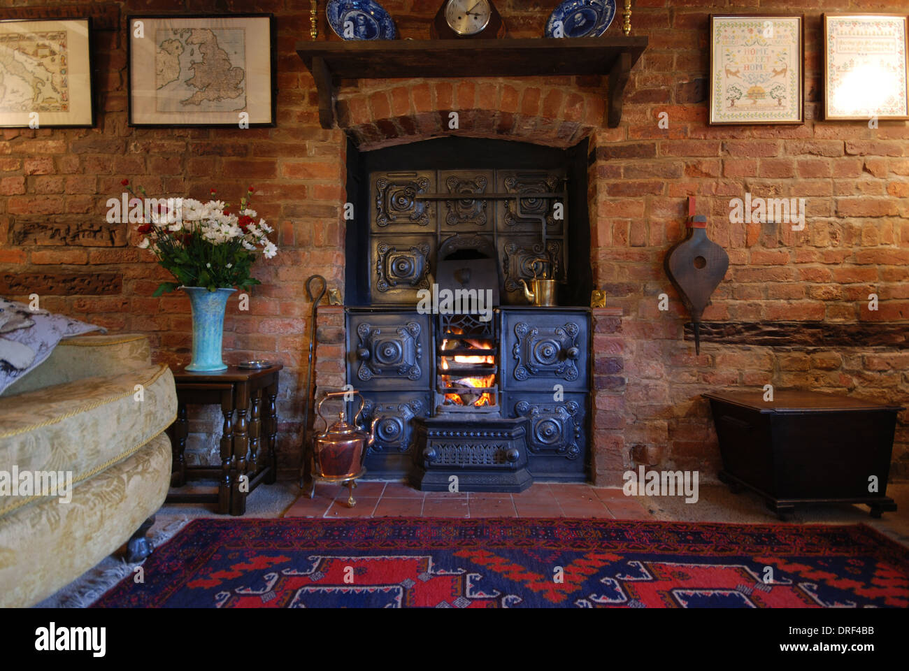Old cottage cast iron stove fireplace Stock Photo, Royalty Free ...