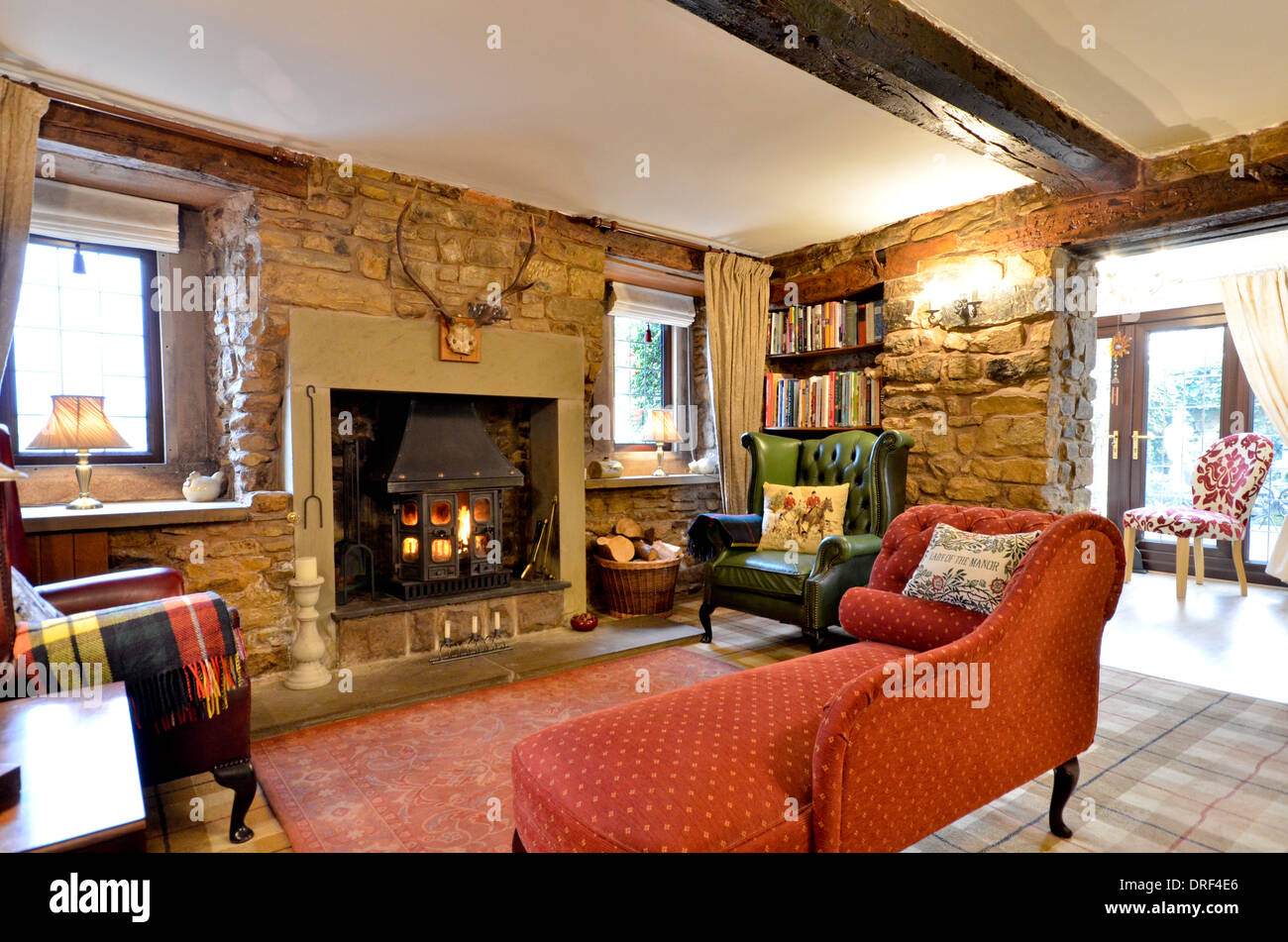 Farmhouse Living Room With Stone Fireplace And Wood Burning Stove Stock Photo Royalty Free