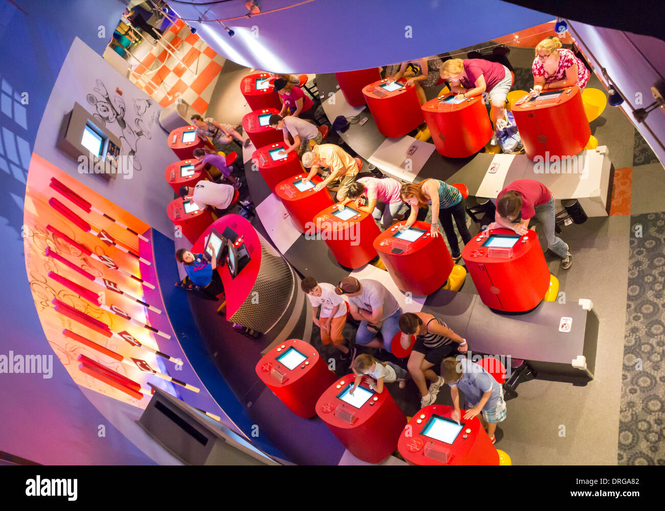 stock photo visitors families children people having fun with video games in disney quest in walt disney world in florida - Childrens Games Free Disney