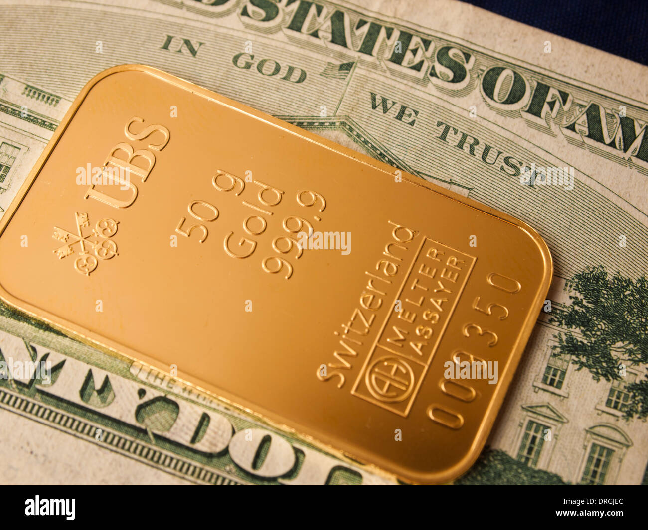 A 50g gold ingot issued by the swiss bank ubs on a us dollar note a 50g gold ingot issued by the swiss bank ubs on a us dollar note buycottarizona Image collections