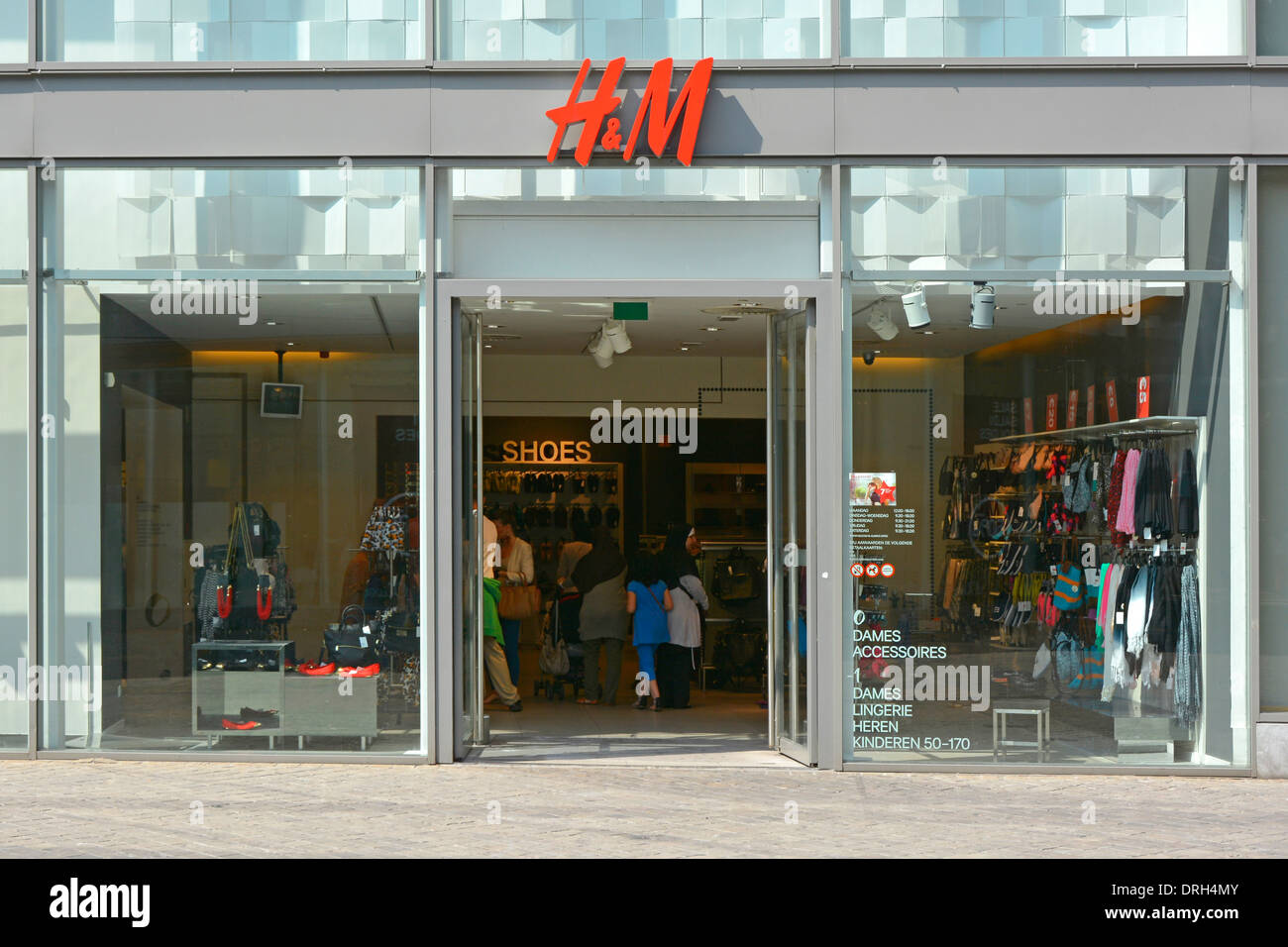 Dutch H&M clothing store shop front with customers and ...