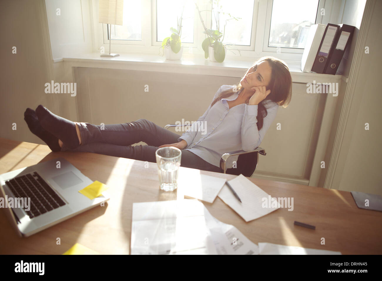 Young Business Woman Sitting At Her Desk In Office With