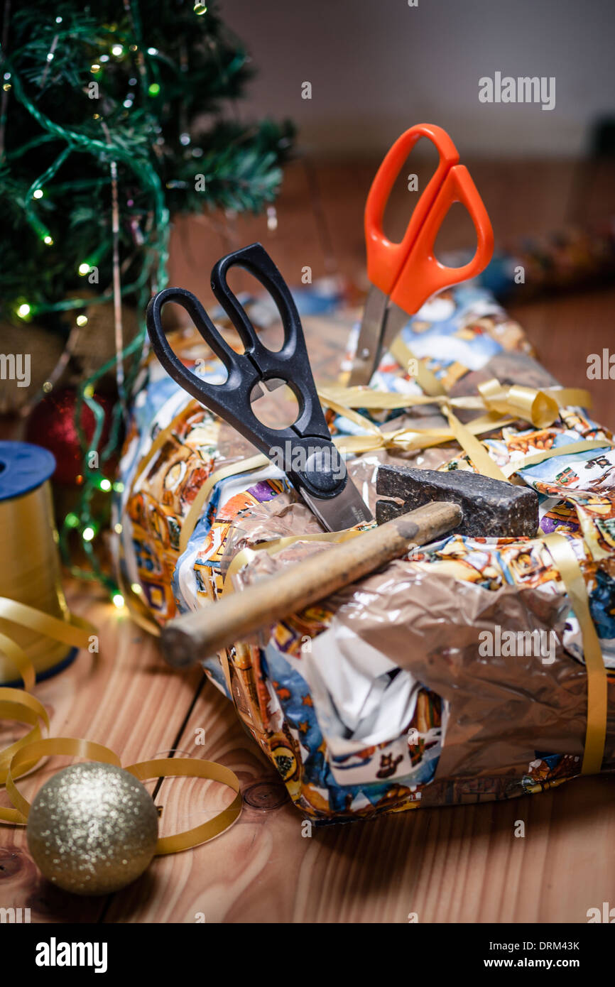 Bad packed christmas gift spiked with scissors stock photo bad packed christmas gift spiked with scissors negle Images
