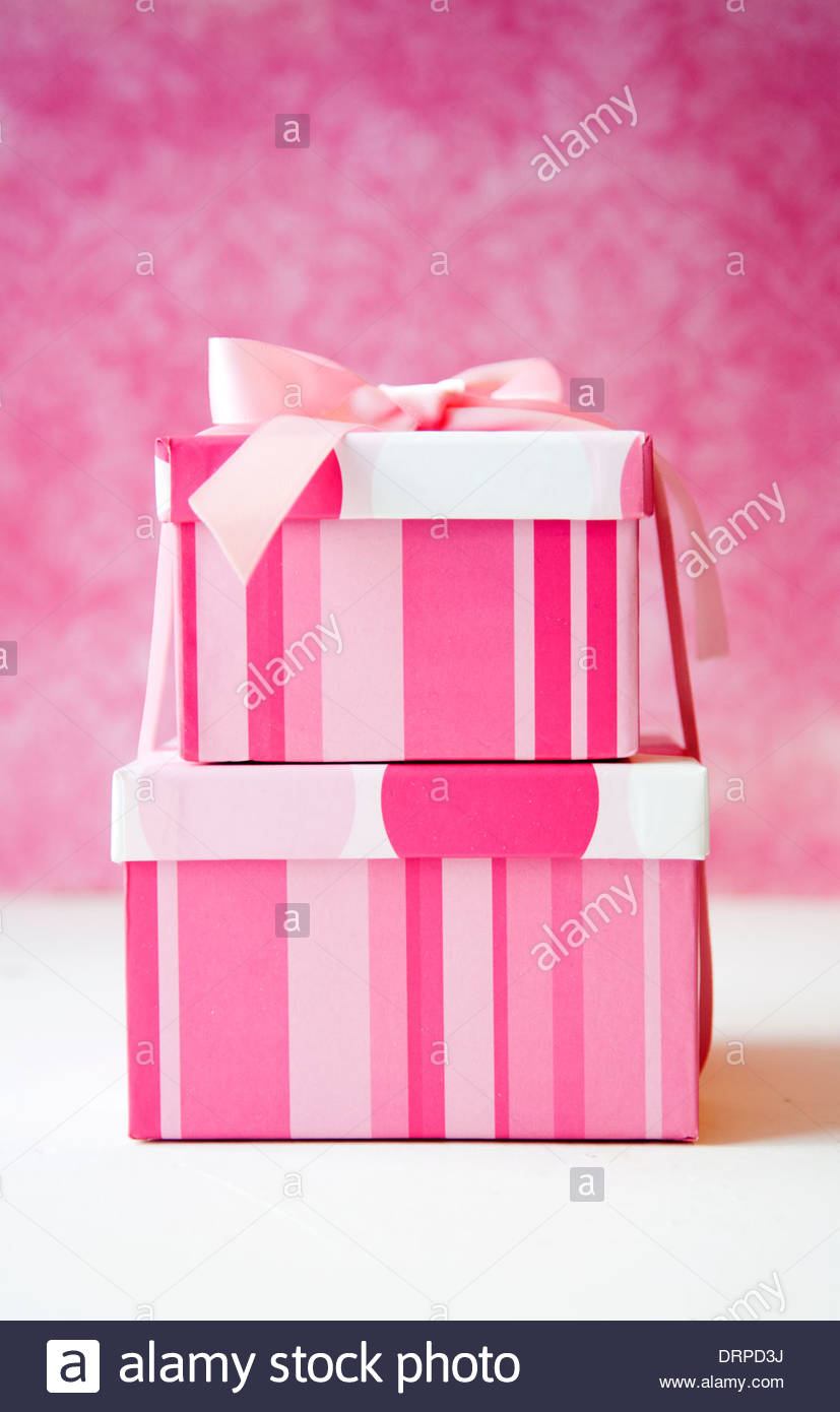 Pink striped gift boxes tied with ribbon against vintage pink wallpaper & Pink striped gift boxes tied with ribbon against vintage pink ... Aboutintivar.Com