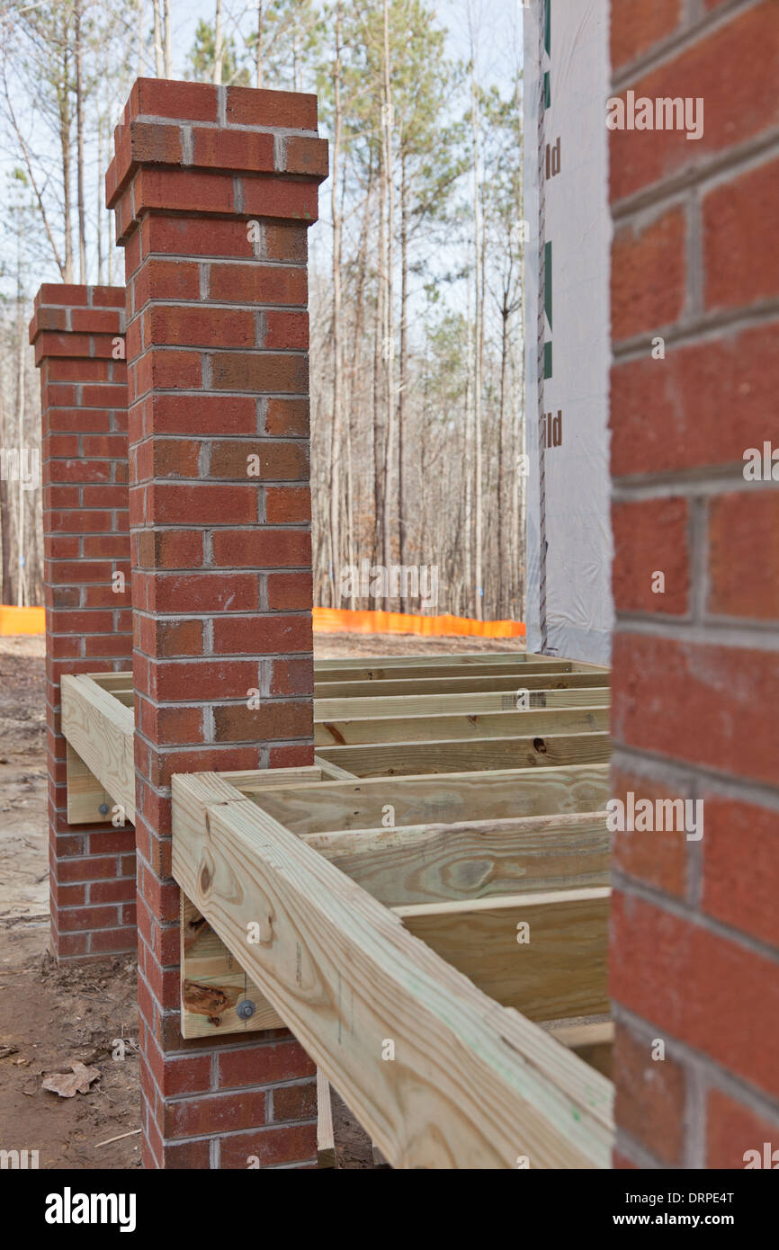 Masonry Building Framed : New home construction wood framing details of a porch with