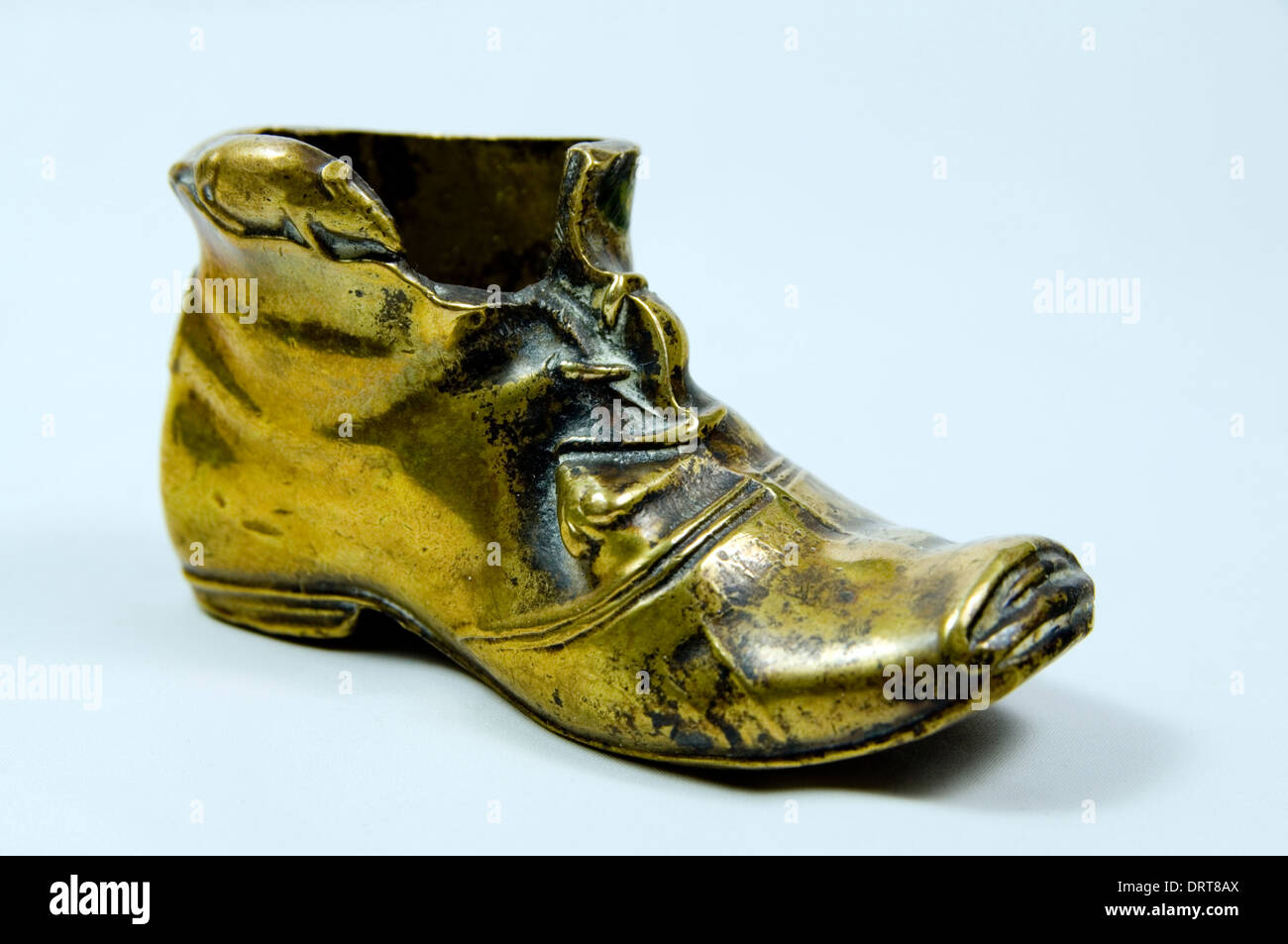 brass boot and mice ornament stock photo royalty free