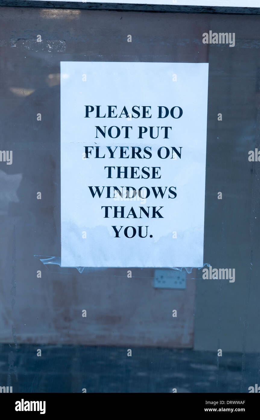 a flyer notice on a window stating please do not put flyers on a flyer notice on a window stating please do not put flyers on these windows thank you