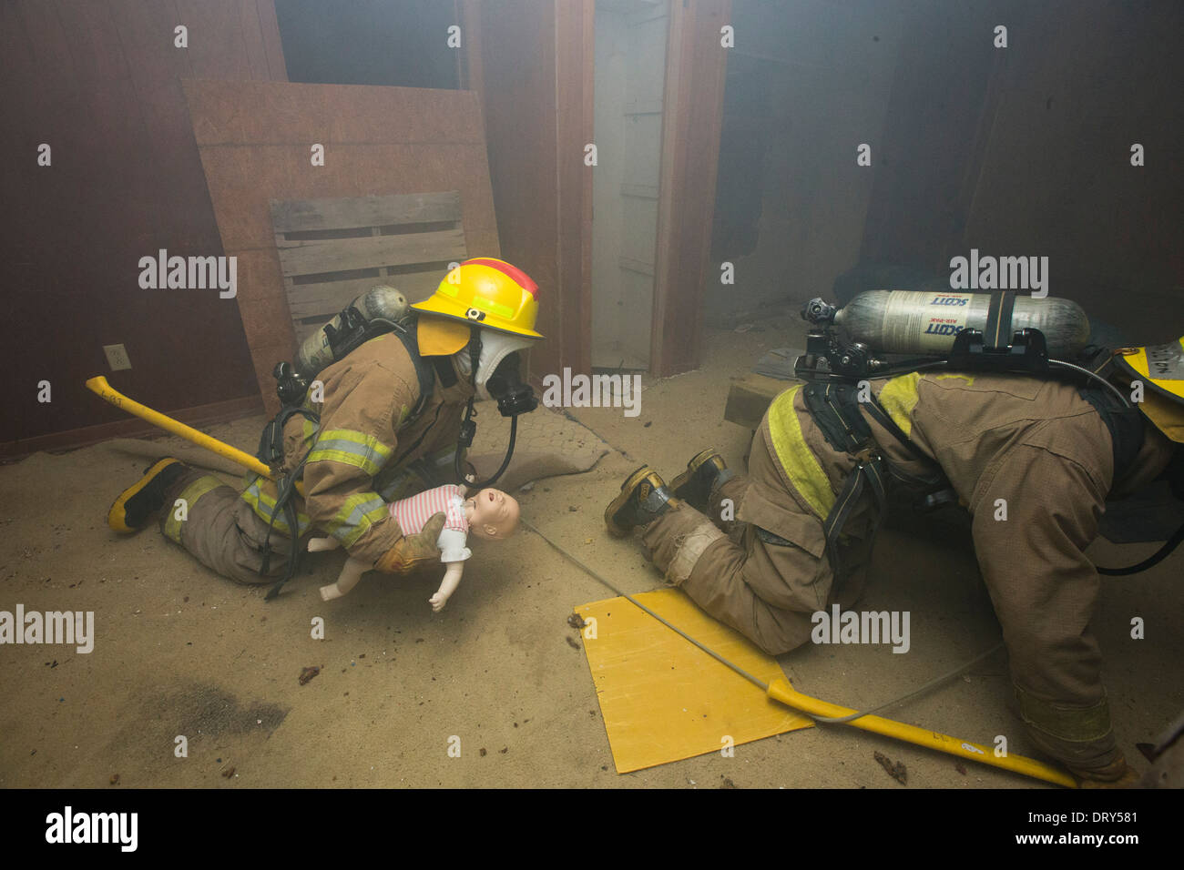 high school fire academy students crawl through smoke filled house high school fire academy students crawl through smoke filled house after rescuing trapped baby