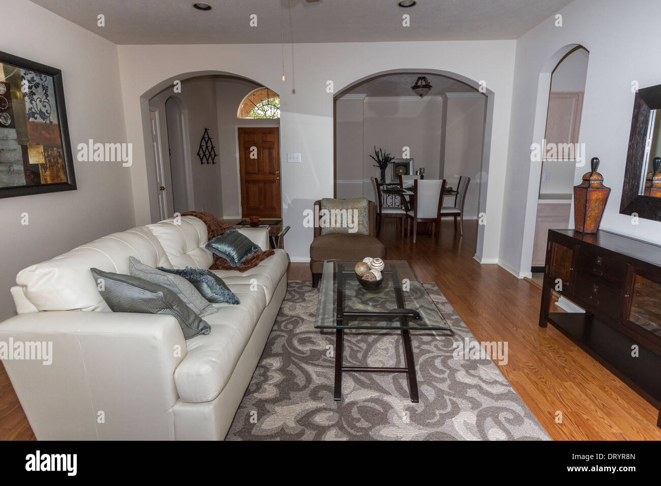 Living Room DIning And Entryway In Mid Size Suburban Home
