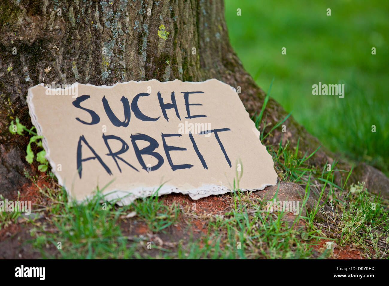 cardboard sign showing the german term suche arbeit in. Black Bedroom Furniture Sets. Home Design Ideas