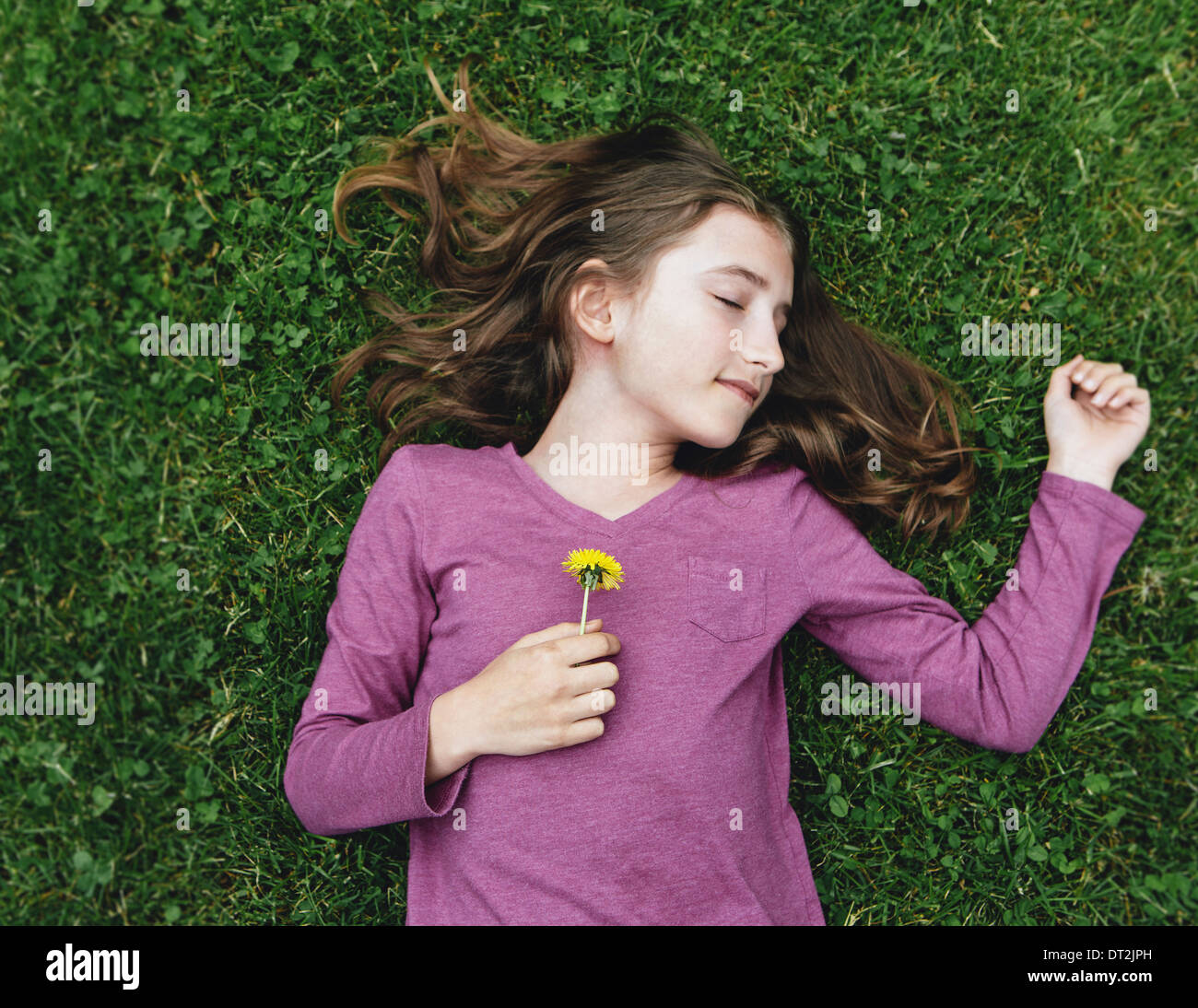 Cool A Ten Year Old Girl Lying On The Grass With Her Eyes Closed Hairstyles For Women Draintrainus