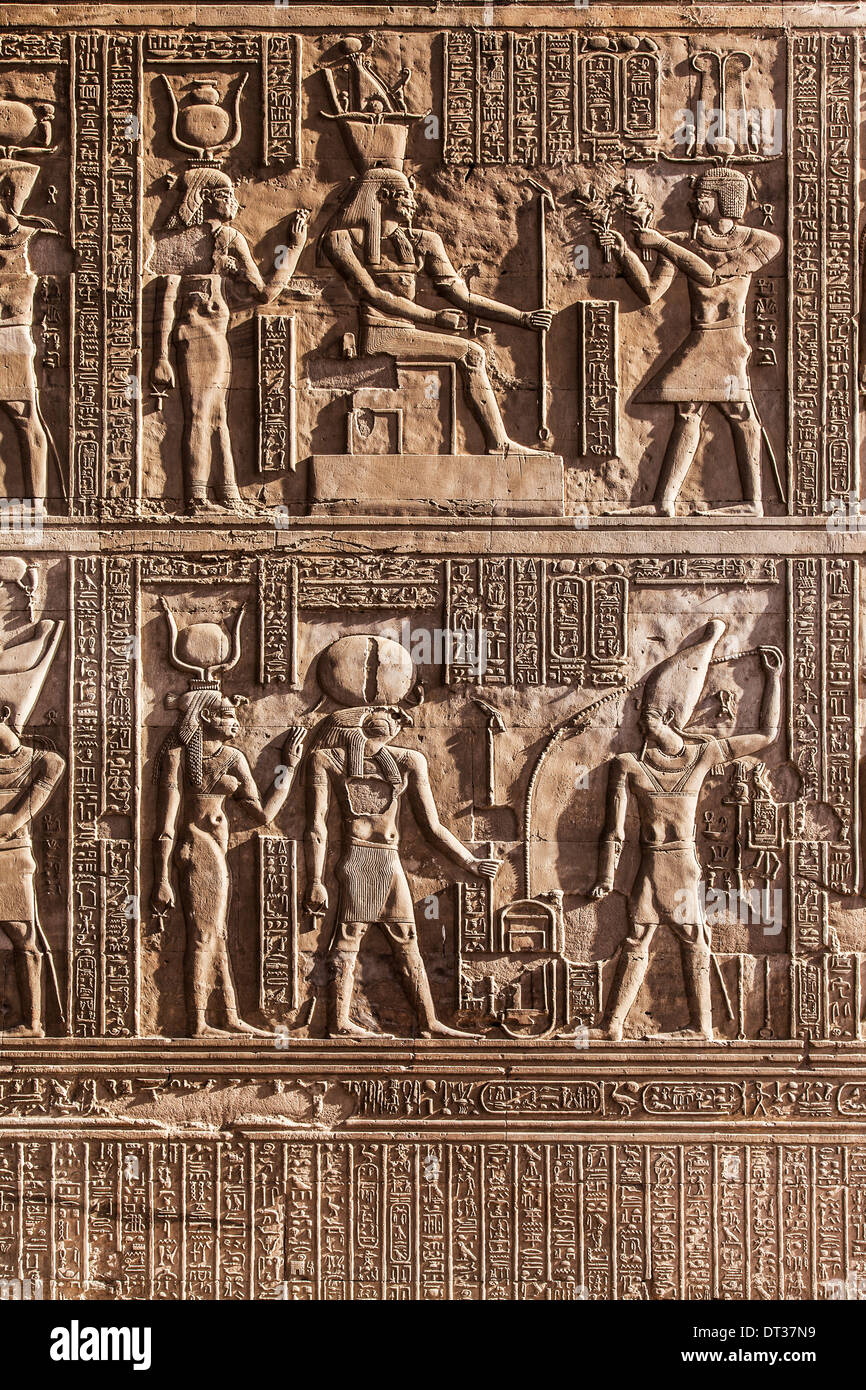 Bas relief carvings on a wall of the ancient egyptian