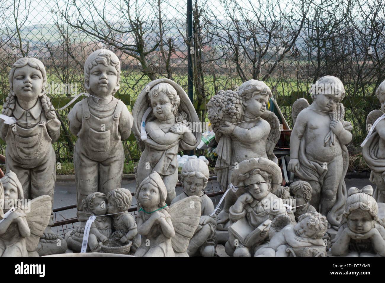 Delightful Garden Ornament Cast Stone Statues For Sale In A Garden Centre   Stock Image