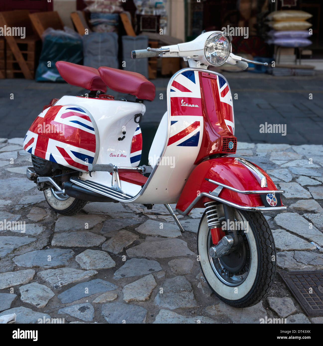 a piaggio vespa scooter, painted with the flag and colours of the