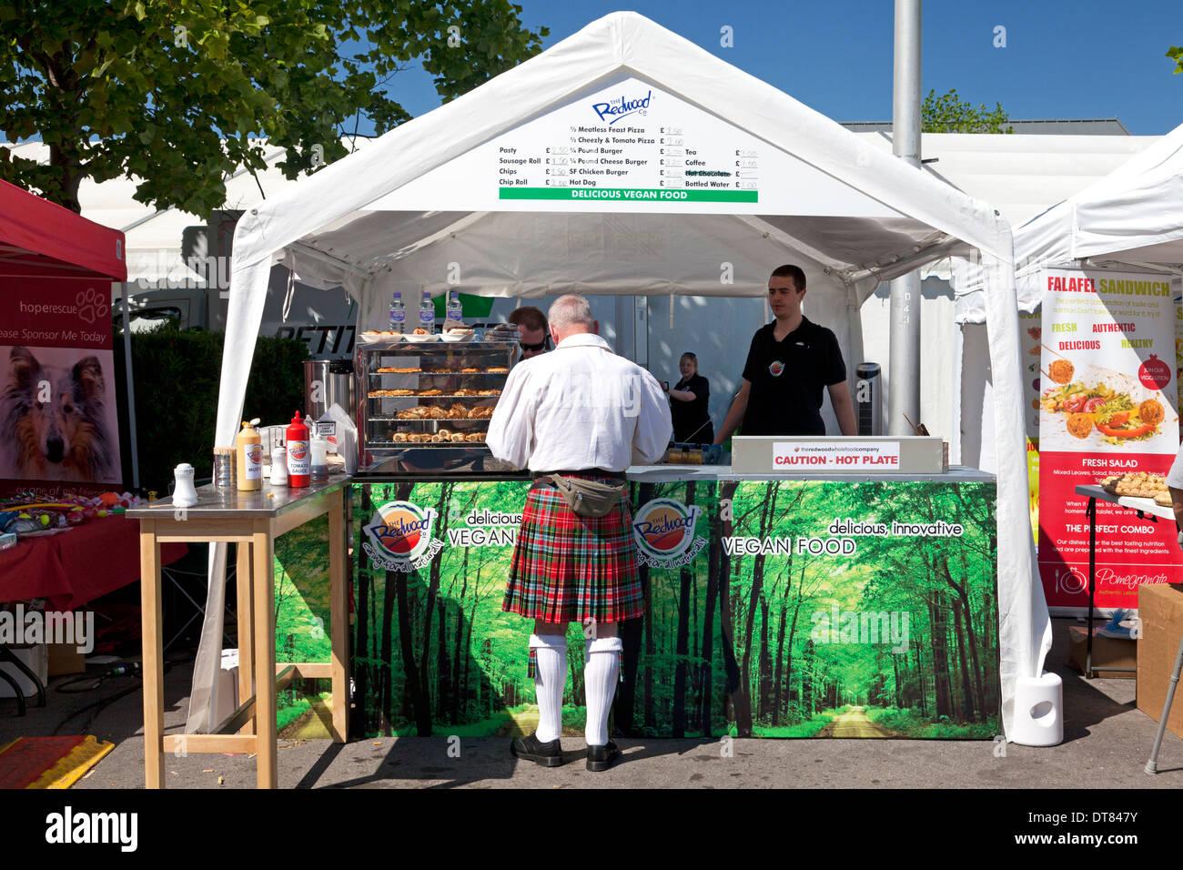 man-in-kilt-at-food-stall-at-bristol-veg
