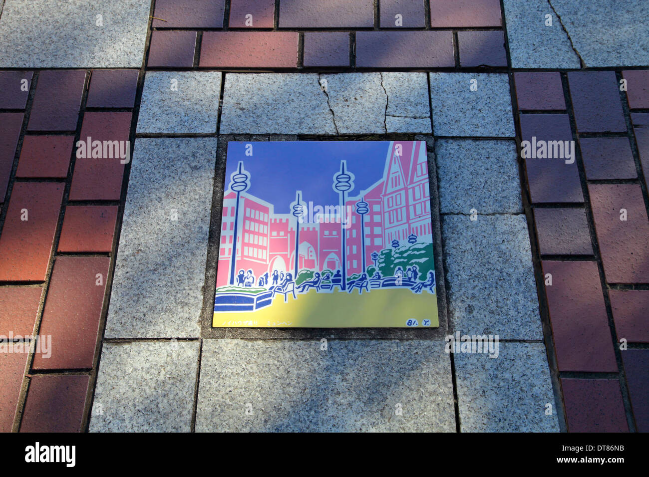 Illustrated tile on the sidewalk Tama Center shopping area Tokyo ...