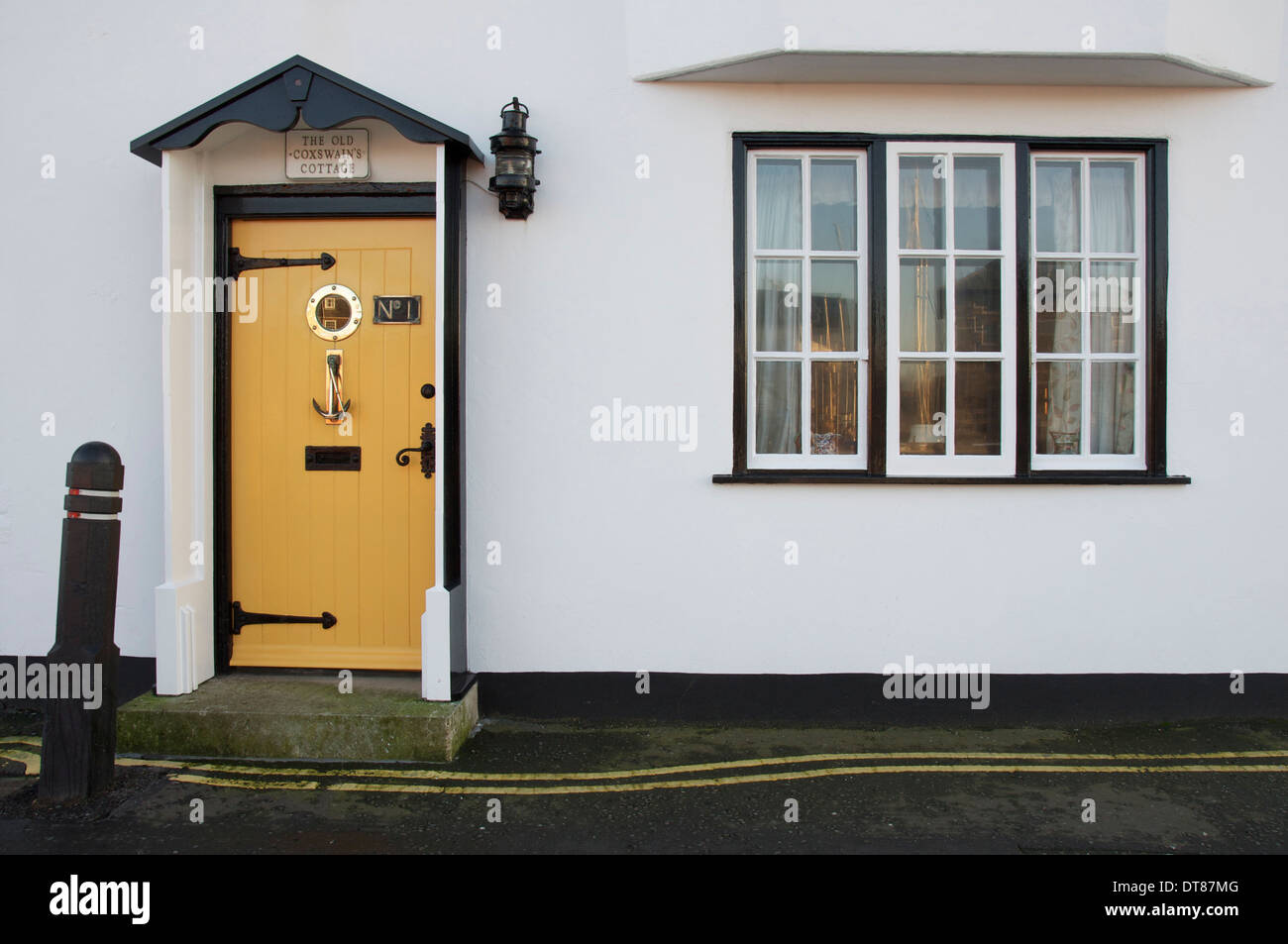 Front door of an old english cottage - Stock Photo The Polished Window And Glossy Yellow Front Door Of The Old Coxswain S Cottage On The Quayside Of Weymouth Harbour In Dorset England