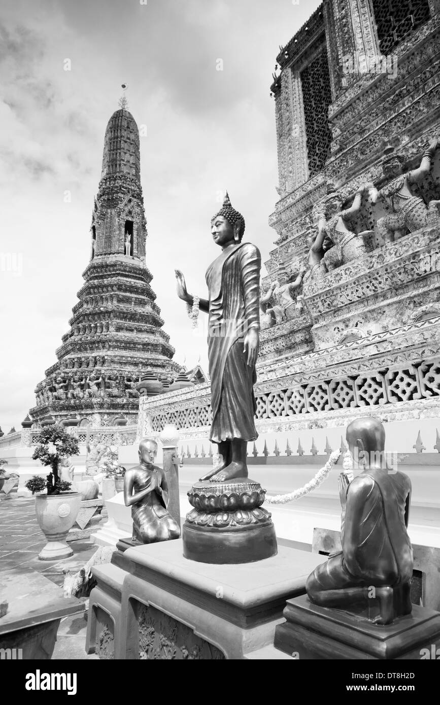Black and white photo of a buddha statue against a scratched black laughing buddha white background thai buddha statues at wat arun thai temple in black and white bangkok thailand buycottarizona