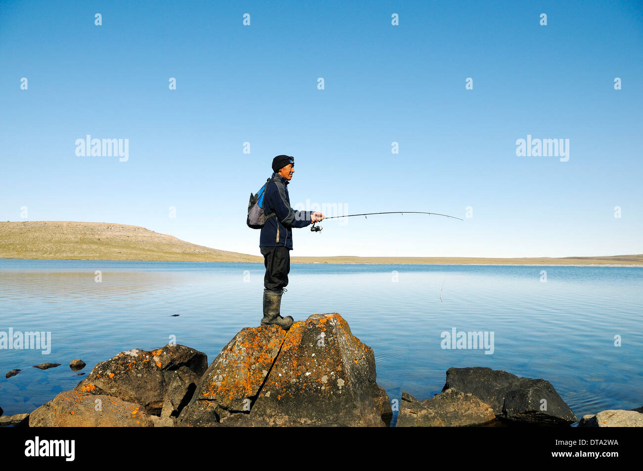 Men of the inuit people fishing in a lake victoria island for Videos of people fishing