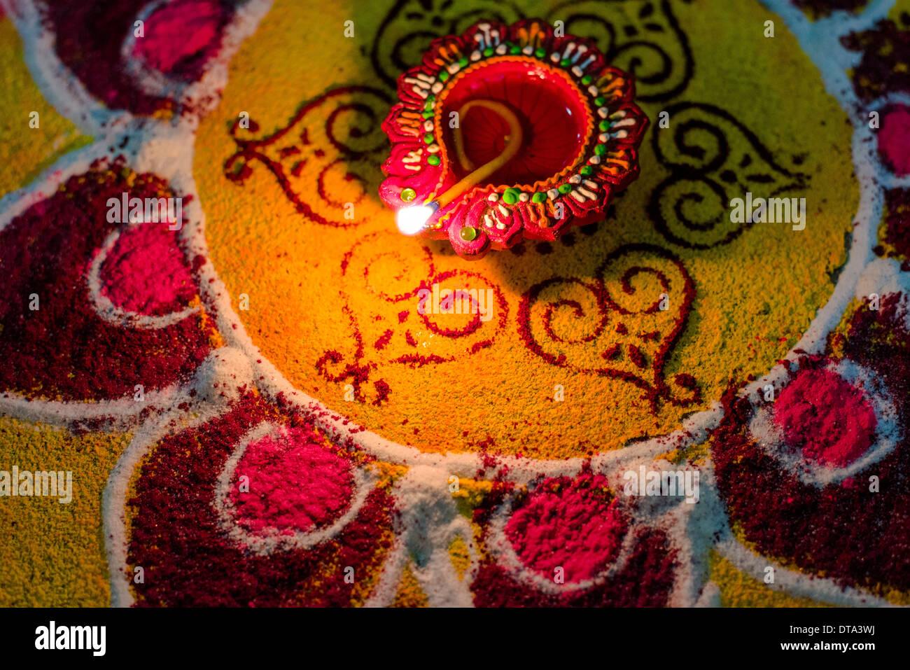 Rangoli An Artwork Made From Colour Powder And An Oil